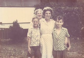 Mother, Granny, my brother and I on the farm.